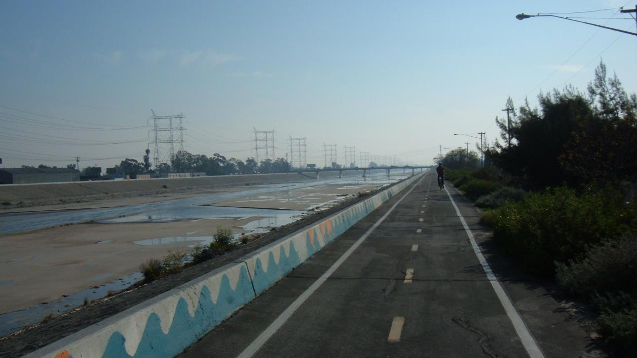 Bike path along LA river with rider in the distance
